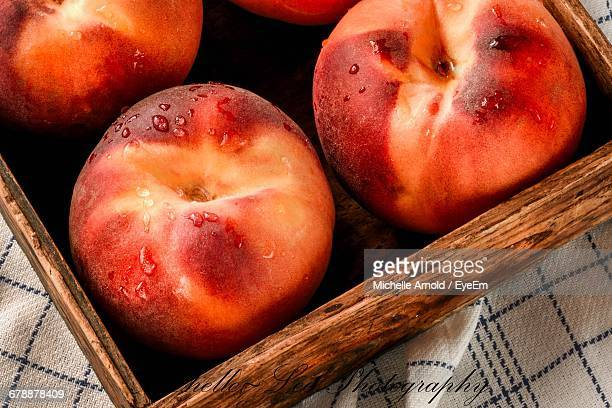 Directly Above Shot Of Peaches In Wooden Tray On Table