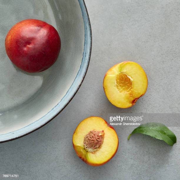 Directly above shot of peaches on table and container