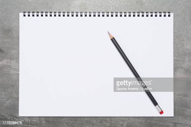 directly above shot of pencil and spiral notebook on table - 鉛筆 ストックフォトと画像