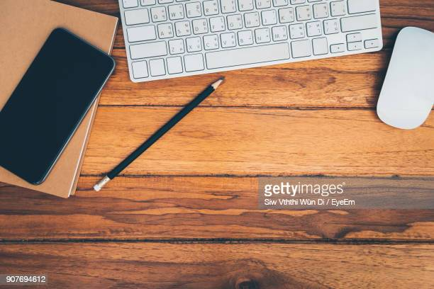 Directly Above Shot Of Pencil By Laptop On Wooden Table