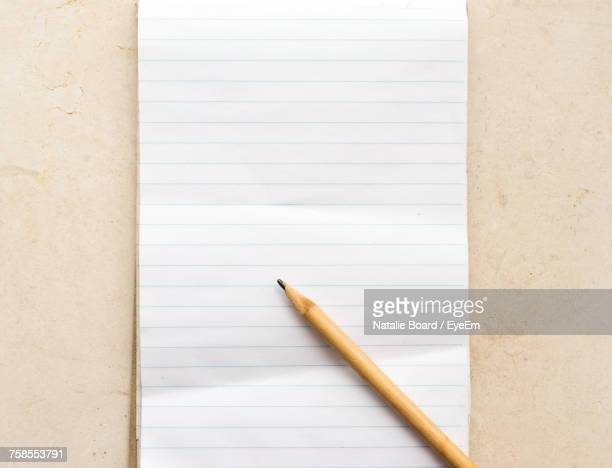 directly above shot of pencil on paper - lined paper stock photos and pictures