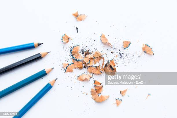 Directly Above Shot Of Pencils By Shavings On White Background