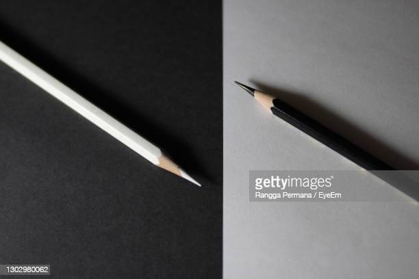 directly above shot of pencils over two tone backgrounds - two tone color stock pictures, royalty-free photos & images