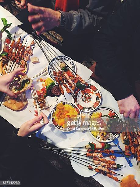 Directly Above Shot Of People Eating Food On Table