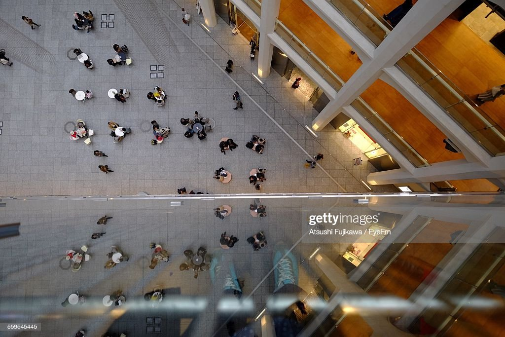 Directly Above Shot Of People Outside Building : Stock Photo
