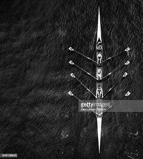 directly above shot of people sailing in rowboat on sea - five people stock pictures, royalty-free photos & images