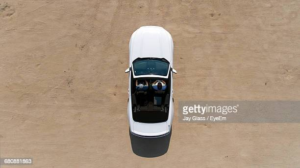 Directly Above Shot Of People Sitting In Car At Mojave Desert