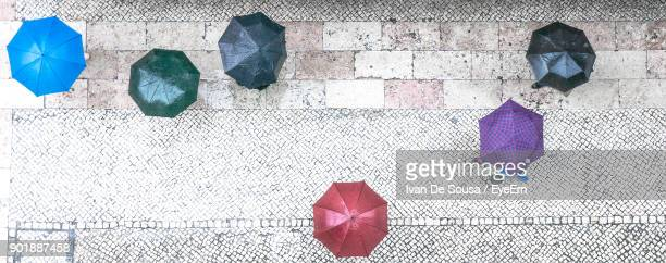 Directly Above Shot Of People Under Umbrellas On Street During Rainy Season