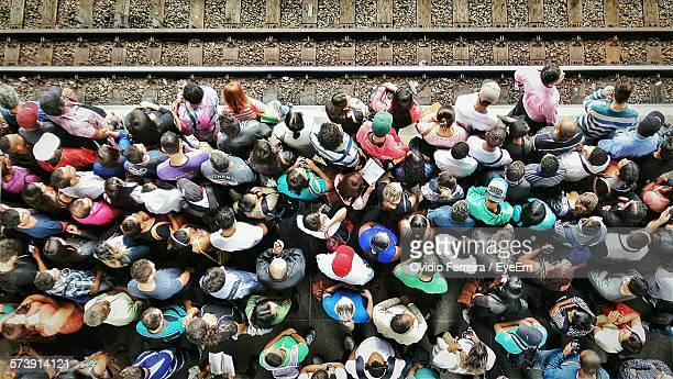Directly Above Shot Of People Waiting At Railroad Station