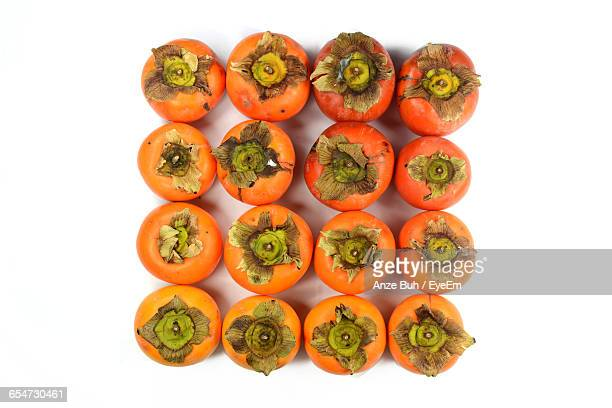 Directly Above Shot Of Persimmons On White Background