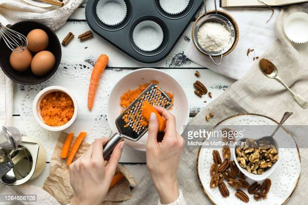 directly above shot of person preparing food on table - dessert stock pictures, royalty-free photos & images