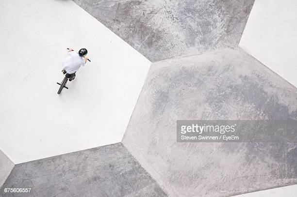 Directly Above Shot Of Person Riding Bmx Cycling At Skateboard Park
