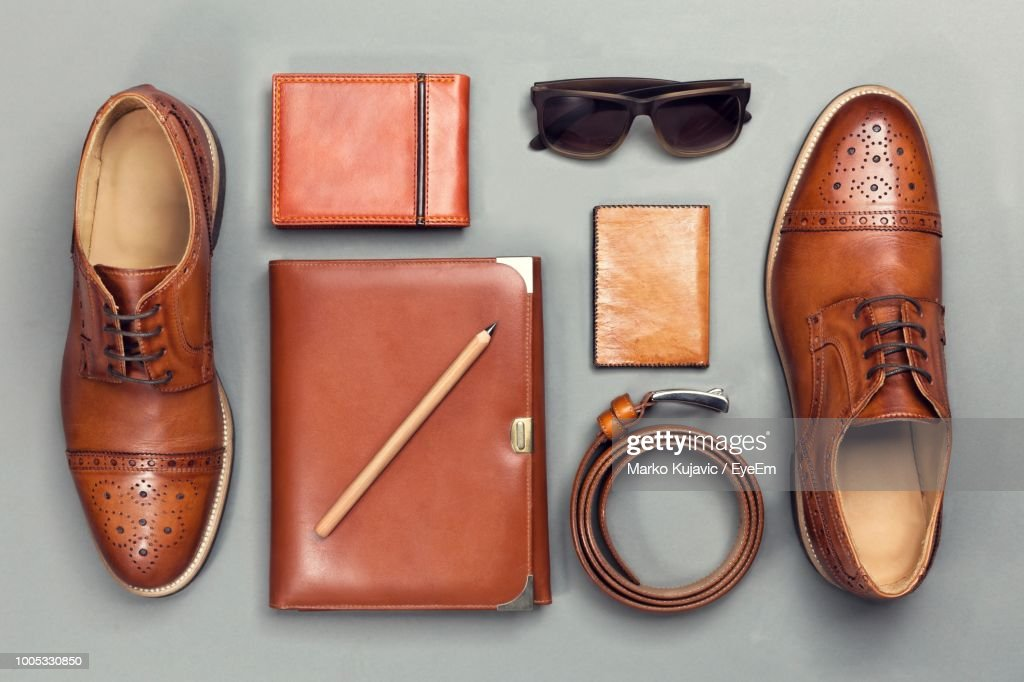 Directly Above Shot Of Personal Accessories On Gray Background : Stock Photo