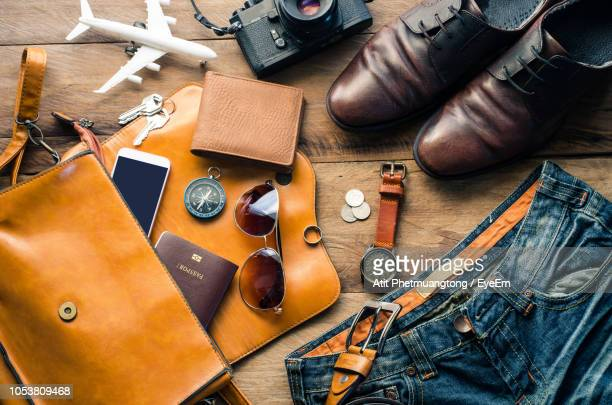 directly above shot of personal accessories on table - men fashion stock photos and pictures