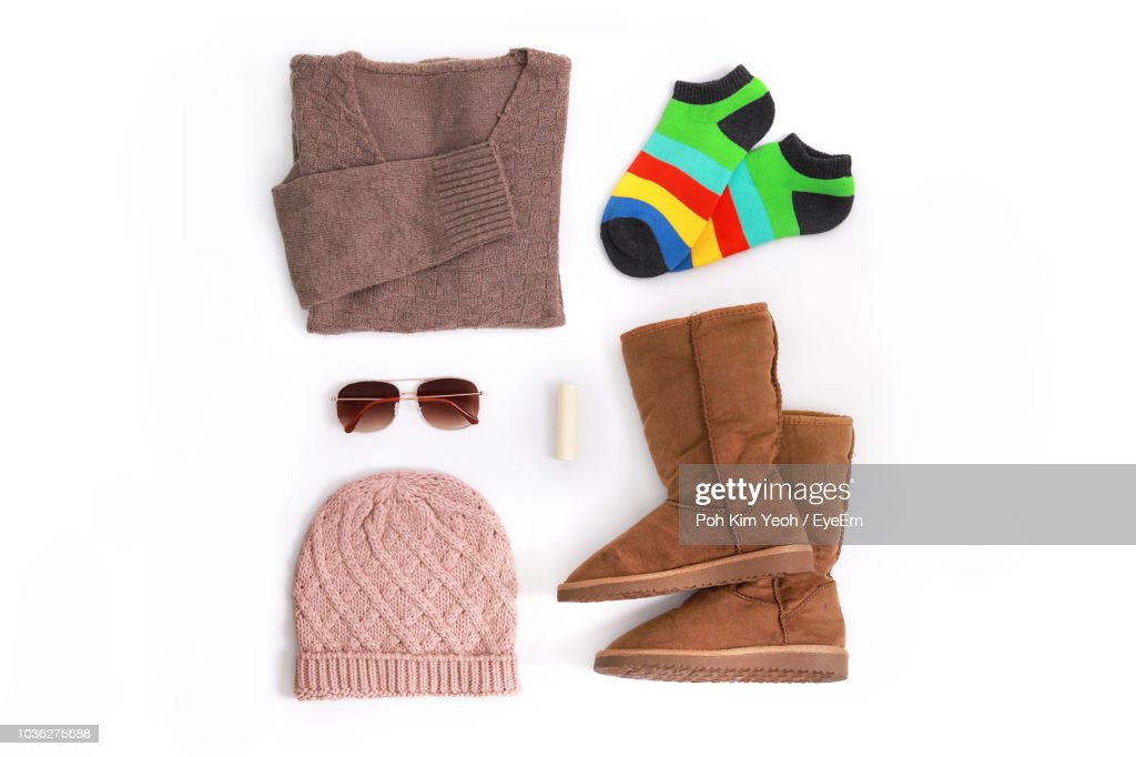 Directly Above Shot Of Personal Accessories On White Background : Stock Photo