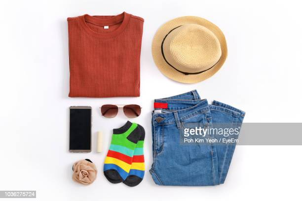 directly above shot of personal accessories on white background - multi colored hat stock pictures, royalty-free photos & images