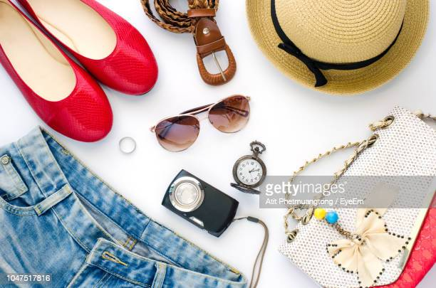 directly above shot of personal accessories on white background - womenswear stock pictures, royalty-free photos & images