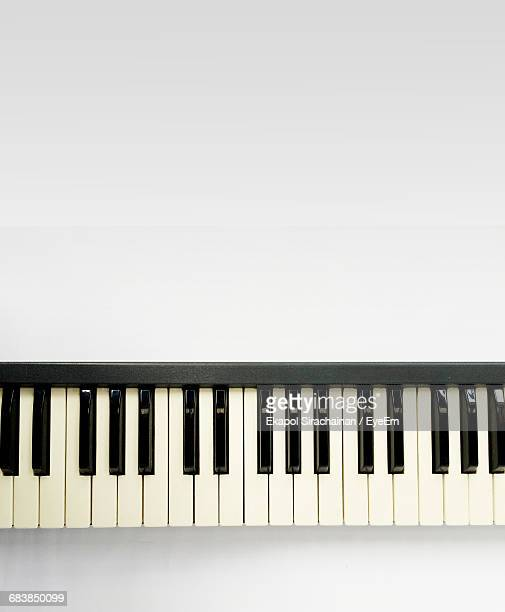 directly above shot of piano against white background - keyboard instrument stock photos and pictures