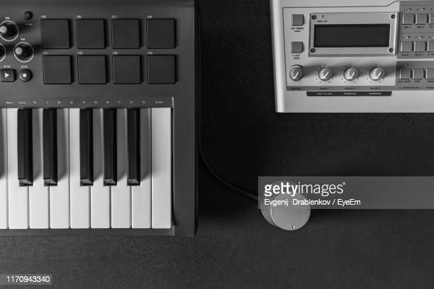 directly above shot of piano with equipment on table - electronic music stock pictures, royalty-free photos & images