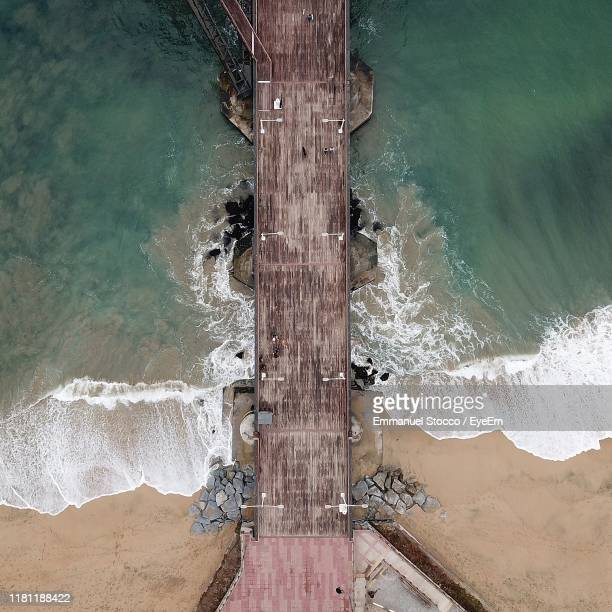 directly above shot of pier over sea - vina del mar stock pictures, royalty-free photos & images
