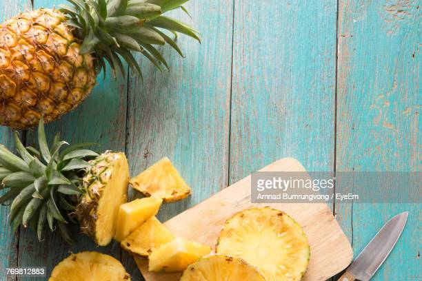 Directly Above Shot Of Pineapple With Slices On Table