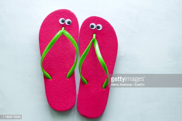 directly above shot of pink flip-flops on floor - googly eyes stock pictures, royalty-free photos & images