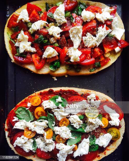 directly above shot of pizza on table - madlen stock-fotos und bilder