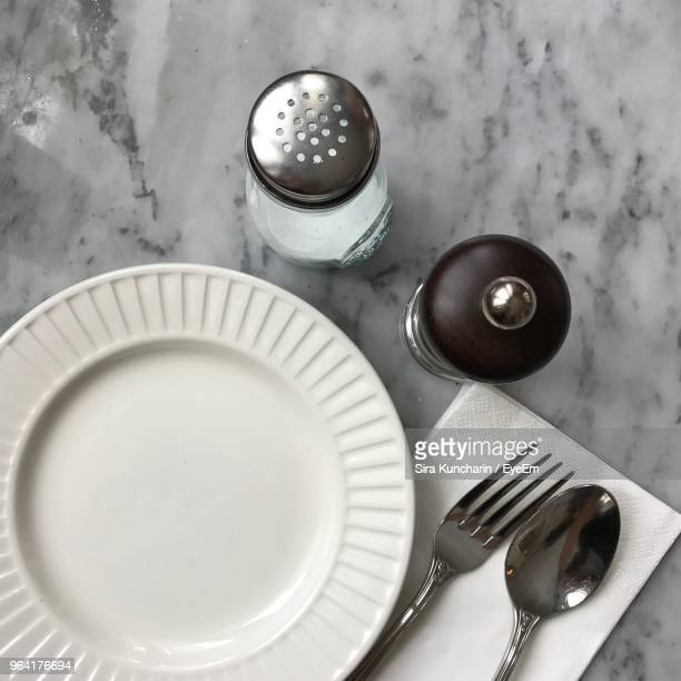 directly above shot of plate on table - pepper mill stock pictures, royalty-free photos & images