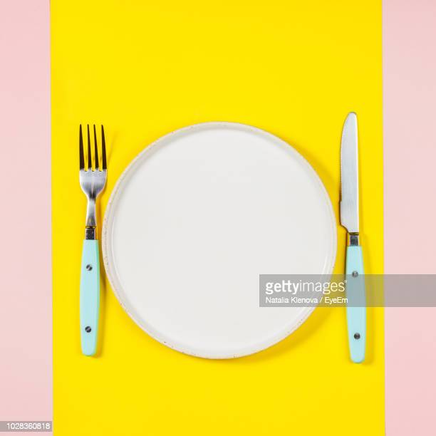 directly above shot of plate with fork and table knife - table knife stock pictures, royalty-free photos & images