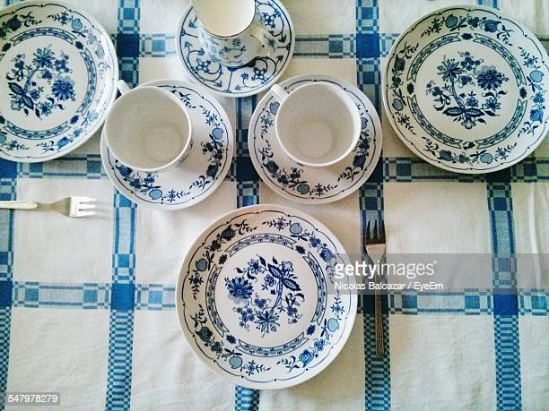 Directly Above Shot Of Plates And Tea Cups Arranged On Table