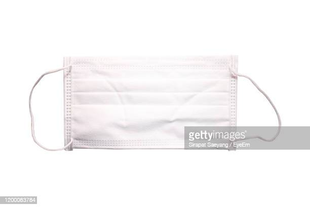 directly above shot of pollution mask over white background - cloth face mask stock pictures, royalty-free photos & images