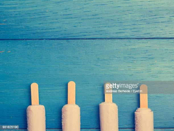 Directly Above Shot Of Popsicles On Blue Table