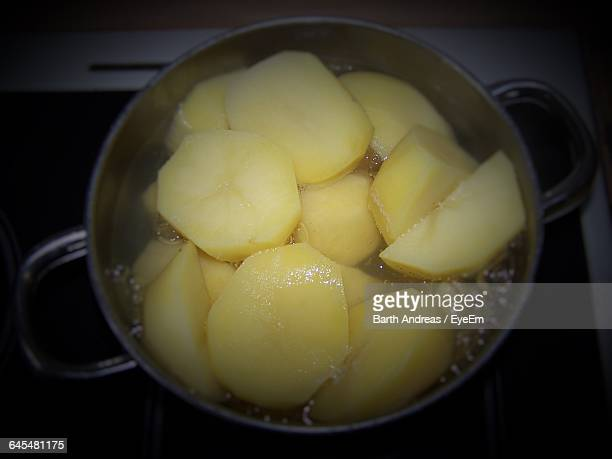 directly above shot of potato boiling in water - boiling stock pictures, royalty-free photos & images
