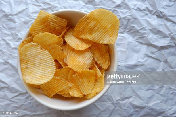 Directly Above Shot Of Potato Chips In Bowl On Table