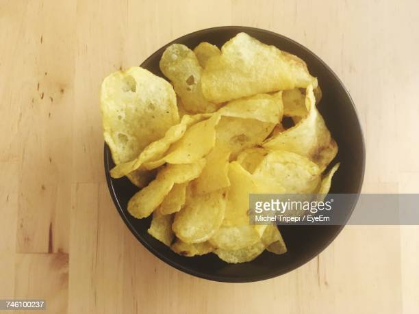 Directly Above Shot Of Potato Chips In Bowl On Wooden Table