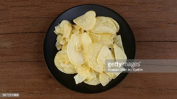 Directly Above Shot Of Potato Chips In Plate On Table