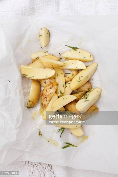 directly above shot of potatoes on paper - prepared potato stock pictures, royalty-free photos & images