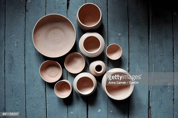 directly above shot of pottery bowls on old table - craft product stock pictures, royalty-free photos & images
