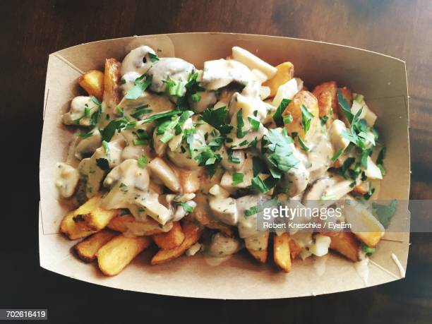 Directly Above Shot Of Poutine On Wooden Table