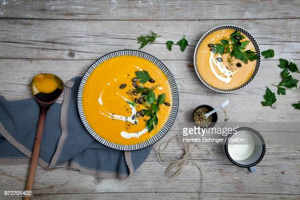 directly above shot of pumpkin soup on table - ladle stock photos and pictures
