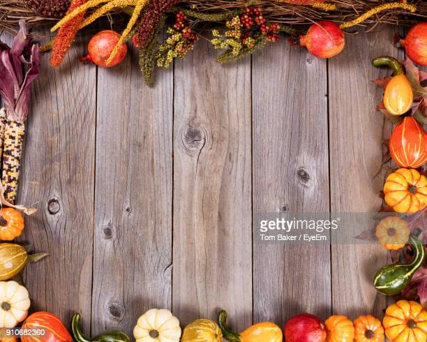 Directly Above Shot Of Pumpkins On Wooden Table