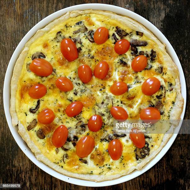 Directly Above Shot Of Quiche Served In Container On Table
