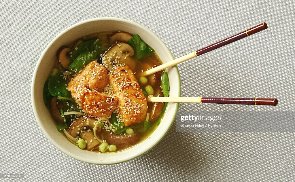 Directly Above Shot Of Ramen Noodles Served In Bowl On Table : Stock Photo