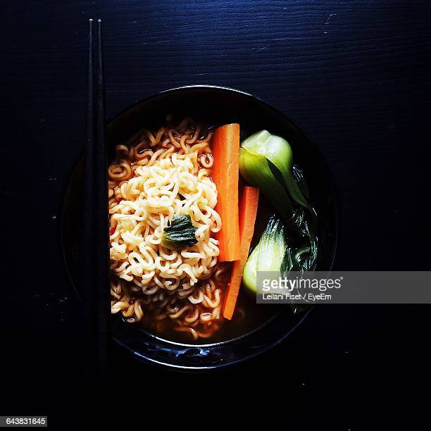 directly above shot of ramen noodles with vegetables served on table - baby bok choy stock photos and pictures