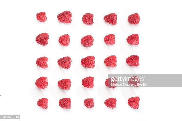 Directly Above Shot Of Raspberries Arranged On White Background