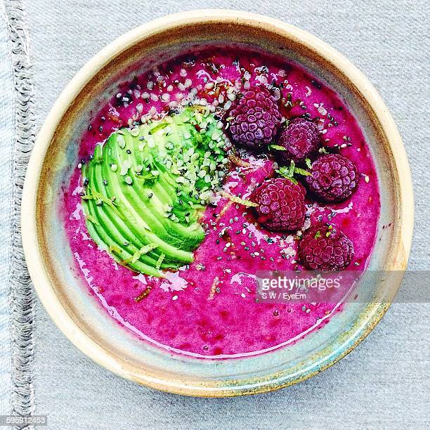 Directly Above Shot Of Raspberry Smoothie With Avocado And Hemp Seeds Served In Bowl