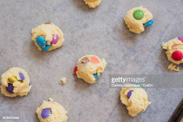 Directly Above Shot Of Raw Cookies With Candies In Bowl On Table