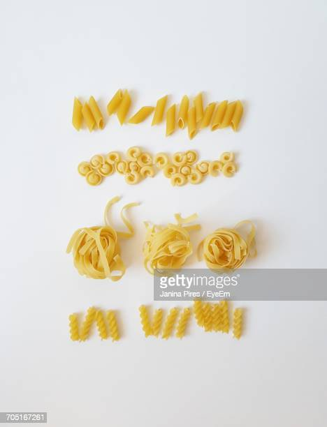Directly Above Shot Of Raw Pasta On White Background