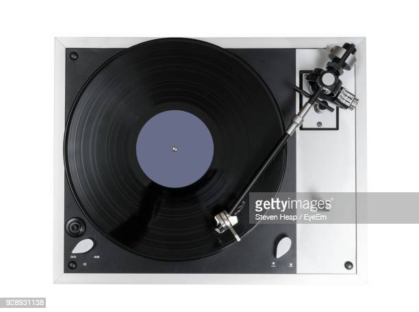 directly above shot of record player needle over white background - gramophone stock pictures, royalty-free photos & images