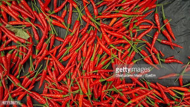 directly above shot of red chili peppers at market stall - shaifulzamri eyeem stock pictures, royalty-free photos & images